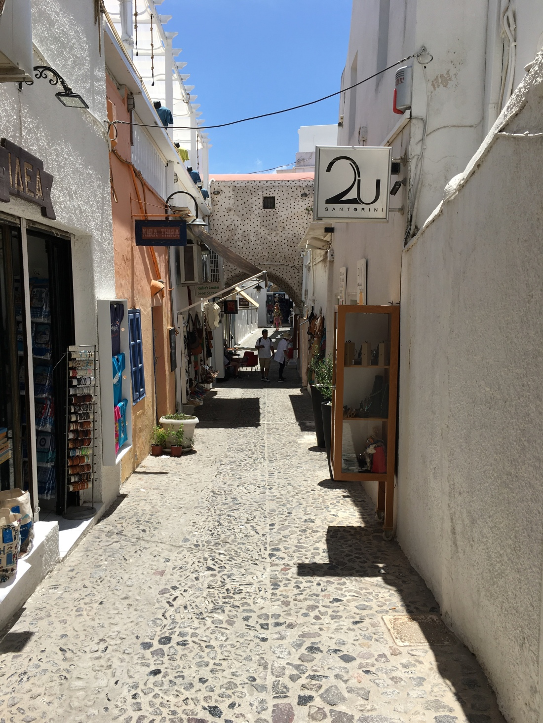 Shopping street in Firi, Santorini. Brownell. 2019