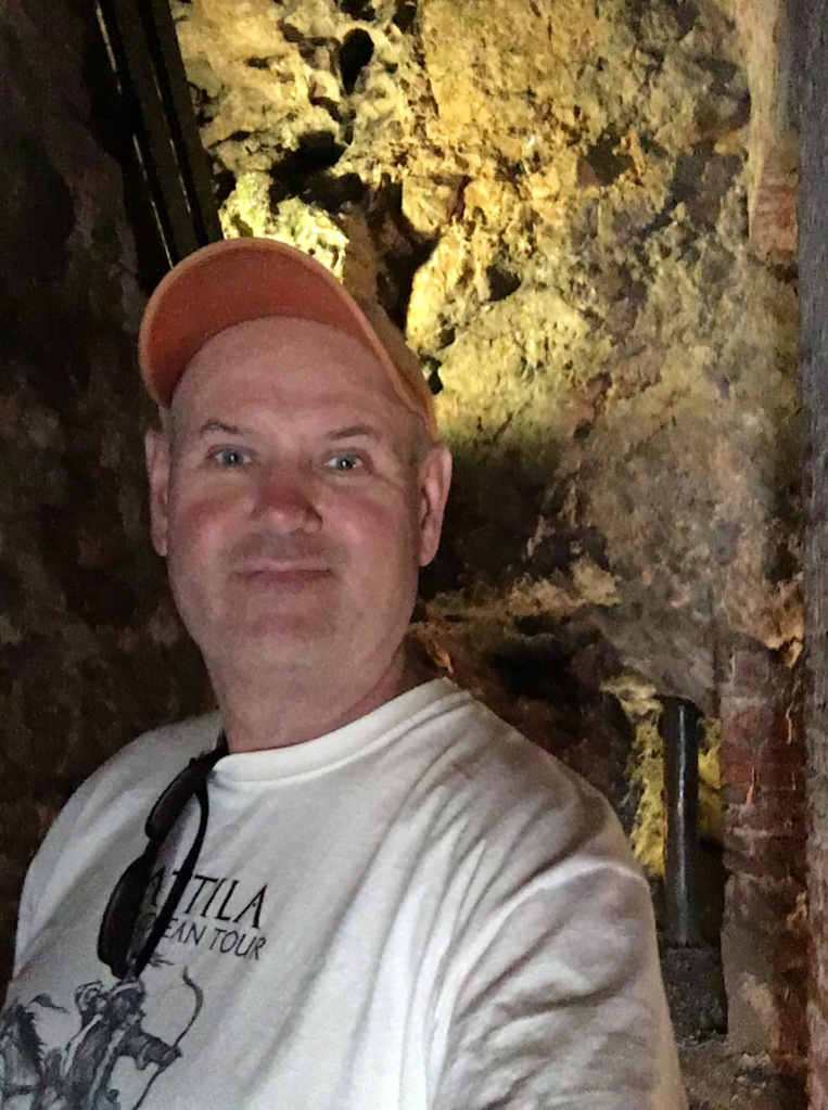 The author inside the main chamber of the Dragon's Den, Wawel Castle, Krakow, Poland. 2019. Brownell.